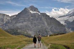 Wandelaars in Grindelwald/eerst Royalty-vrije Stock Afbeelding