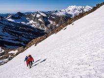 Wandelaars op de bergen Stock Foto