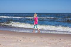 Wander at sandy coastline Stock Photos