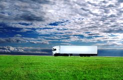 The wanderer. Blank truck in the field under beautiful sky Stock Photos