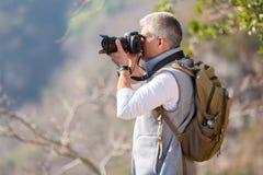Wanderer, der Fotos nimmt Stockbilder