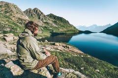 Wanderer Man enjoying lake and mountains Royalty Free Stock Image