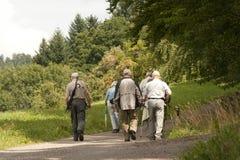Wanderer, seniors on tour in nature