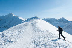 Wanderer and rocky mountains in the winter. Wanderer, rocky mountains in the winter and tourists at the top Royalty Free Stock Photography