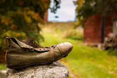 Wanderer shoe in countryside Stock Photos
