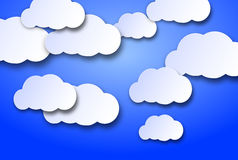 Wandering clouds. On a blue background with 3d effect Royalty Free Stock Photography