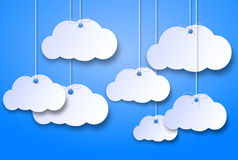 Wandering clouds. On a blue background with 3d effect Stock Images
