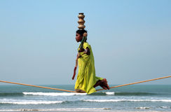 Wandering indian tightrope walker Stock Photo