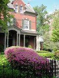 Wandering in Louisville. Historic downtown house with blossoming landscape stock images