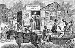 Wandering photograph with moving atelier, vintage engraving. Vintage engraving of wandering photograph offering his service and skills to the people in a village Stock Image