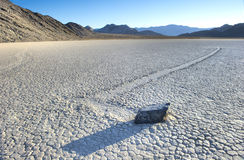 Wandering rock, the racetrack, death valley , california. unexpl. Afternoon sunlight falls on mysterious wandering rock, the racetrack, death valley national Stock Photo