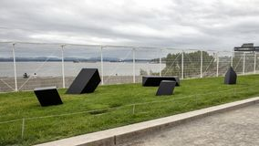 `Wandering Rocks` by Tony Smith, Olympic Sculptue Park, Seattle, Washington, United States. Pictured is a steel painted black sculpture titled `Wandering Rocks` stock photo