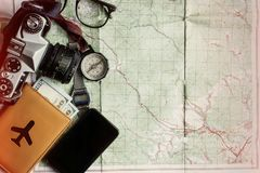 Wanderlust and adventure concept, old compass watch photo camera. Passport and money lying on map, top view, space for text, vintage toned image Stock Photo