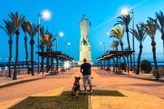 Wanderlust man and dog at Cristofer Collumbus monument in Spain.  Royalty Free Stock Photo