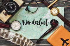 Wanderlust text sign on map. travel concept, hipster flat lay. p Stock Photos