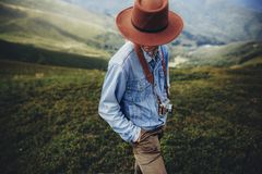 Wanderlust and travel concept. man traveler in hat with photo ca Royalty Free Stock Image