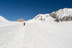 Wandern im Winter Stockbild