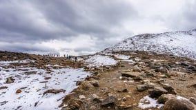 Wandern zur Spitze des Pfeifer-Berges Stockbild