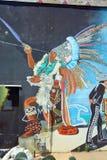 Wandgemälde erzählen die Geschichte von Mexikaneramerikanerleuten Stockfoto