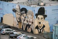 Wandgemälde mit den Porträts von John Wayne, Elvis Presley, Marilyn M Lizenzfreie Stockbilder