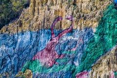 Wandgemälde Mural de la Prehistoria The der Vorgeschichte gemalt auf einer Klippenwand im Vinales-Tal, Kuba stockfotografie