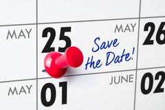 Wandkalender mit einem roten Stift - 25. Mai Stockfotografie
