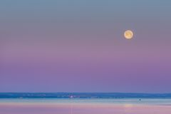 Wane over Sea. Moon over bay. Royalty Free Stock Images