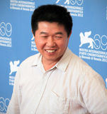 Wang Bing. Poses for photographers at 69th Venice Film Festival on September 8, 2012 in Venice, Italy Stock Images