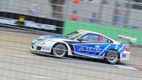 Wang Jian Wei racing at Porsche Carrera Cup Asia Royalty Free Stock Image