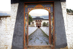 Wangduechhoeling Palace ruins, Bumthang, Bhutan. Decorated door at the entrance of the Wangduechhoeling Palace ruins, Bumthang, Bhutan. The palace was built in Royalty Free Stock Images