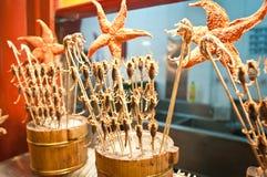 Wangfujing Snack Street. Fried scorpions on a stick on street food stall at Wangfujing Snack Street in Dongcheng District, Beijing, China Stock Photos