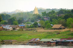 Wangka, mon minority village. Wangka, mon minority village inhabited by mon refugees from burma, on khao laem reservoir artificial lake, sangkhlaburi. The Chedi Stock Photos