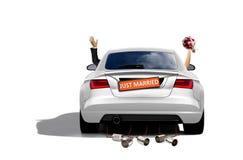 Właśnie para małżeńska w sportowym samochodzie Obraz Royalty Free