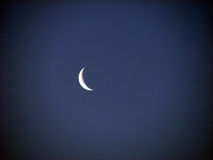 Waning Crescent Moon. A perfect waning crescent moon in the peaceful night sky Royalty Free Stock Photos
