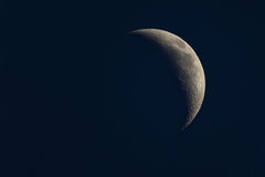 Waning crescent moon phase. Sharp details royalty free stock photos
