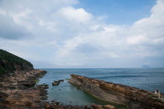 Wanli District, New Taipei City, Taiwan Yehliu Geopark Datun Mountains headland protruding sea Royalty Free Stock Image