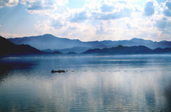 Wanlvhu lake,guangdong china. A boat floating in the blue,clean and clear lake Royalty Free Stock Photography