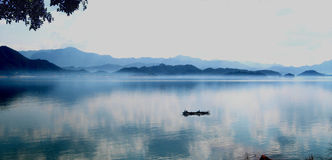 Wanlvhu lake,heyuan,guangdong china. A boat floating in the blue,clean and clear lake Royalty Free Stock Photo