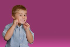 Wanna Fight?. Young boy, with fists up, ready for a playful fight Stock Images