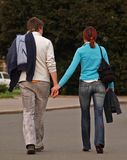She Wanna Hold His Hand. Young couple in trendy clothes Royalty Free Stock Image