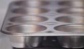 Wanne des kleinen Kuchens oder des Muffins, leer, Hintergrund stockfotografie