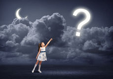 Want know all. Cute girl in dress holding question mark on rope Royalty Free Stock Photo