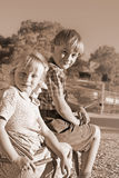 Want a lift young boy and girl Royalty Free Stock Image