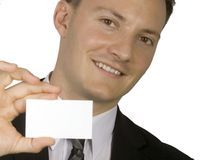Want my business card?. A businessman is showing his business card royalty free stock photos