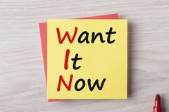 Want It Now Concept. Want It Now written on yellow note and marker pen on wooden desk. Win concept stock photo