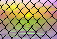 Want to be free. Fence and ocean view as a symbol for our dreams about freedom Royalty Free Stock Image