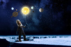 He want to become astronaut . Mixed media Stock Photography