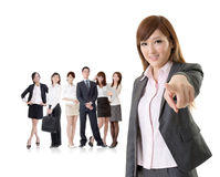 We want you. Asian business women point at you in front of her team isolated on white background royalty free stock photos