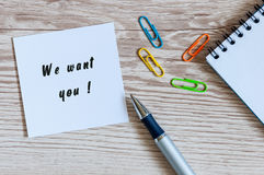 We Want You - card or notice on white workplace background with offise suplies Royalty Free Stock Photography