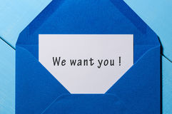 We Want You - text in letter at open blue envelope on workplace. Business concept Stock Image